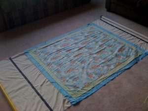 Quilt back top and bottom attached to the leaders