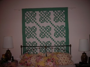 Green and white quilt Sandy mentioned, which hangs above her bed.  She must have the sweetest dreams.