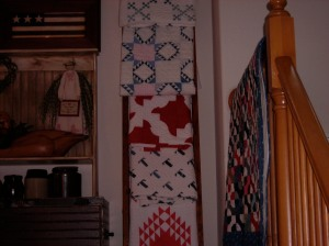 More lovely quilts greet us as we climb the stairs.