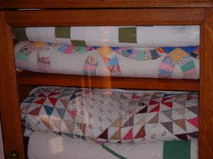 More quilts stored on the stair landing