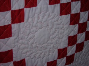 Sandy had this one quilted in red.  I wish I had got a picture with the full effect.  It's quite amazing.  I guess I will have to go back and get more pictures.